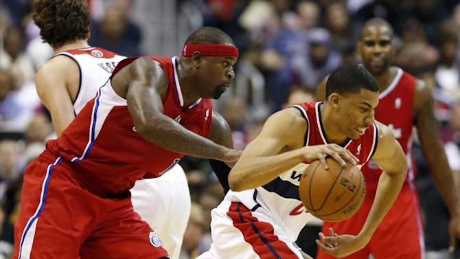 Washington Wizards forward Otto Porter Jr. (22) drives around Los Angeles Clippers forward Stephen Jackson (1) in the first half of an NBA basketball game on Saturday, Dec. 14, 2013, in Washington. The Clippers won 113-97