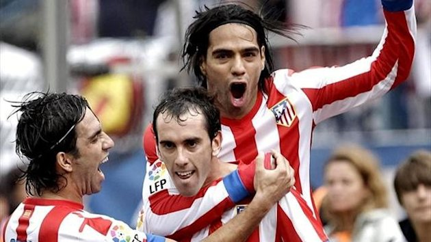 Falcao, Arda and Godin celebrating a goal