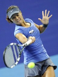 Li Na of China returns a ball during her women's singles match against Shuai Peng of China at the China Open tennis tournament in the National Tennis Centre in Beijing. Li Na won 4-6, 6-2, 7-6