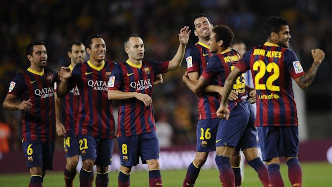 FC Barcelona's Sergio Busquets, third right. reacts after scoring with his teammate Neymar, from Brazil, second right, against Real Sociedad during a Spanish La Liga soccer match at the Camp Nou stadium in Barcelona, Spain, Tuesday, Sept. 24, 2013