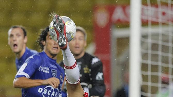 Monaco's Layvin Kurzawa of France challenges for the ball with Bastia's Francois J Modesto of France during their French League One soccer match, in Monaco stadium, Wednesday, Sept, 25, 2013