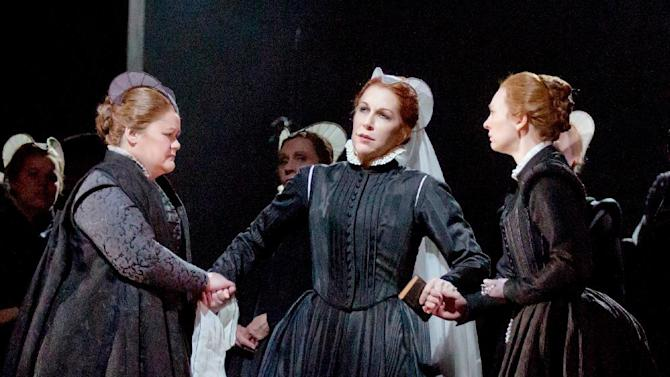 "In this Dec. 21, 2012 photo provided by the Metropolitan Opera, Joyce DiDonato, center, plays Maria Stuarda during a dress rehearsal of Donizetti's ""Maria Stuarda,"" at the Metropolitan Opera in New York. (AP Photo/Metropolitan Opera, Ken Howard)"