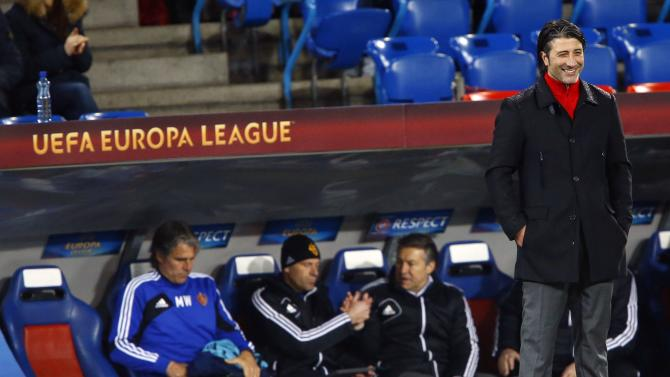 FC Basel's coach Yakin smiles after their Europa League soccer match against Maccabi Tel Aviv in Basel
