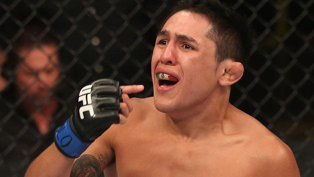 Erik Perez reacts after knocking out Ken Stone in his debut at UFC 150. (Getty)