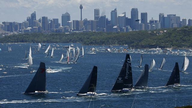 Sailing - Sydney-Hobart favourite Wild Oats leads out of Harbour