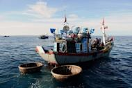 A fishing boat leaves Ly Son Island off the central province of Quang Ngai in August 2012. Swept along by nationalist sentiment, and forced to venture ever further out to sea to fill its nets, Asia's fishing fleet is increasingly on the frontline of escalating territorial tensions in the region