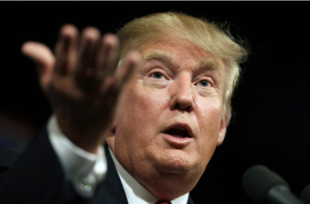 FILE- In this June 16, 2015 file photo, Republican presidential candidate Donald Trump speaks to supporters during a rally in Des Moines, Iowa. Donald Trump's lawyers said Trump and the Miss Unive