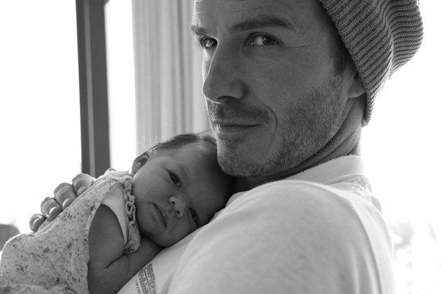 """Victoria shared a picture of """"baby Harper cuddling Daddy"""" on August 7"""