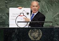 NEW YORK, NY - SEPTEMBER 27: Benjamin Netanyahu, Prime Minister of Israel, points to a red line he drew on a graphic of a bomb while discussing Iran during an address to the United Nations General Assembly on September 27, 2012 in New York City. The 67th annual event gathers more than 100 heads of state and government for high level meetings on nuclear safety, regional conflicts, health and nutrition and environment issues. (Photo by Mario Tama/Getty Images)
