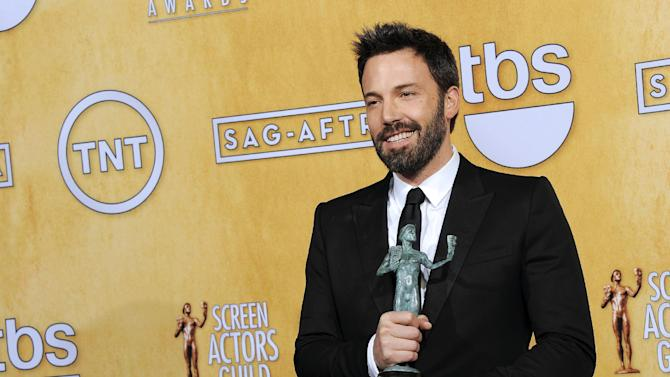 """FILE - In this Sunday, Jan. 27, 2013 file photo, actor Ben Affleck poses backstage with the award for best cast in a motion picture for """"Argo"""" at the 19th Annual Screen Actors Guild Awards at the Shrine Auditorium in Los Angeles. A best-picture win at the upcoming Oscars could be viewed as righting a wrong after Affleck inexplicably missed out on a best-director nomination. (Photo by Chris Pizzello/Invision/AP, File)"""