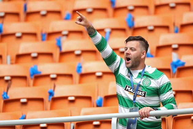 Celtic fan in the stands before the game