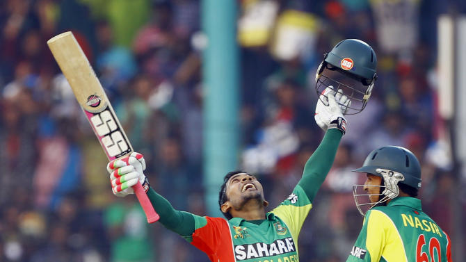 Bangladesh's Mushfiqur Rahim, left, celebrates after scoring a century, as Nasir Hossain smiles during the Asia Cup one-day international cricket tournament against India in Fatullah, near Dhaka, Bangladesh, Wednesday, Feb. 26, 2014. (AP Photo/A.M. Ahad)