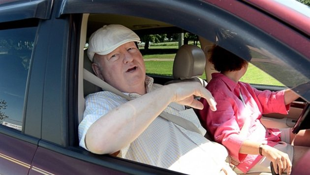 Mike Duffy sits in a vehicle outside a Kensington, P.E.I. dog kennel on Friday July 18, 2014. (CP Photo)