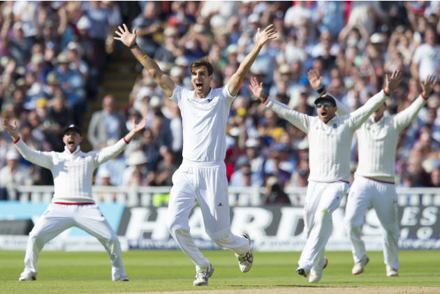 England's Steven Finn, center, appeals unsuccessfully for a catch against Australia's Peter Nevill on the second day of the third Test match of the five match series between England and Austra