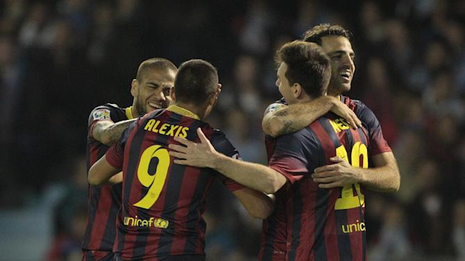 FC Barcelona's Cesc Fbregas, background right, celebrates  with teammates after scoring the third goal against RC Celta during a Spanish La Liga soccer match at the Balaidos stadium in Vigo, Spain, Tuesday, Oct. 29, 2013