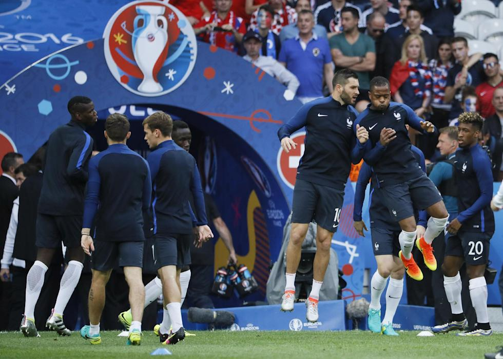 France's Patrice Evra and Andre Pierre Gignac warm up before the game