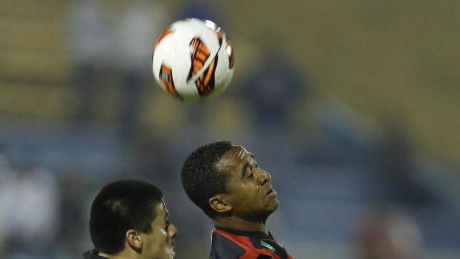Jorge Moreira, of Paraguay's Libertad, left, fights for the ball with Brazil's Sport Recife's Airton at a Copa Sudamericana soccer game in Asuncion, Paraguay, Wednesday, Sept. 25, 2013