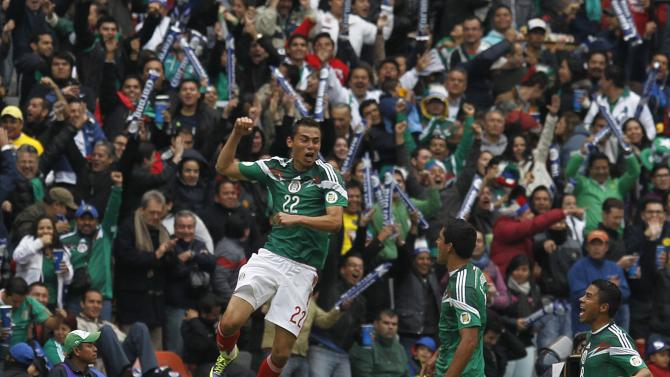 Mexico's Paul Aguilar celebrates his goal with team mates during their 2014 World Cup qualifying playoff first leg soccer match against New Zealand at Azteca stadium in Mexico City
