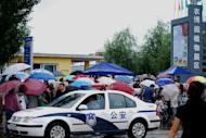 File photo of a police car in Jilin on August 28, 2010. A Chinese car thief strangled a two-month-old baby to death after stealing a vehicle with the infant inside, police said, provoking outrage across the country Wednesday
