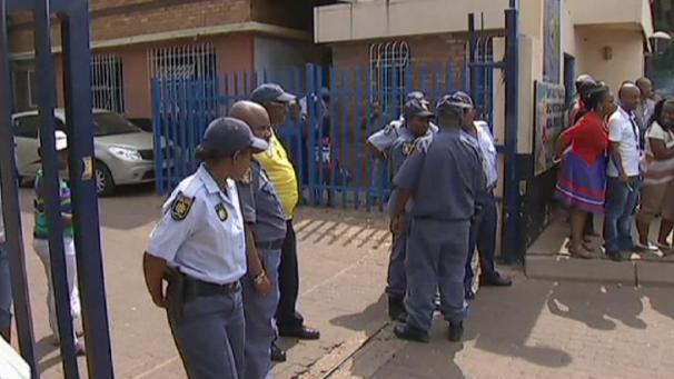 Police suspended after South Africa taxi driver death