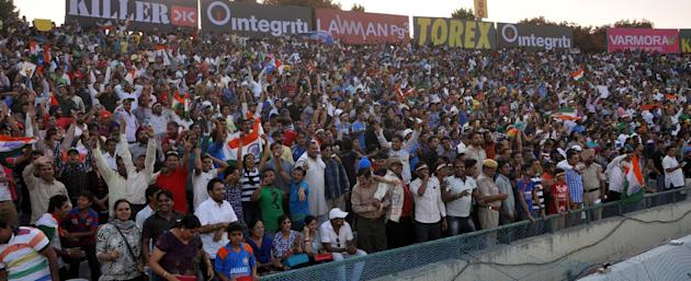 Cricket fans cheer during the 3rd ODI between India and Australia at Punjab Cricket Association Stadium, Mohali, Chandigarh on Oct. 19, 2013. (Photo: IANS)