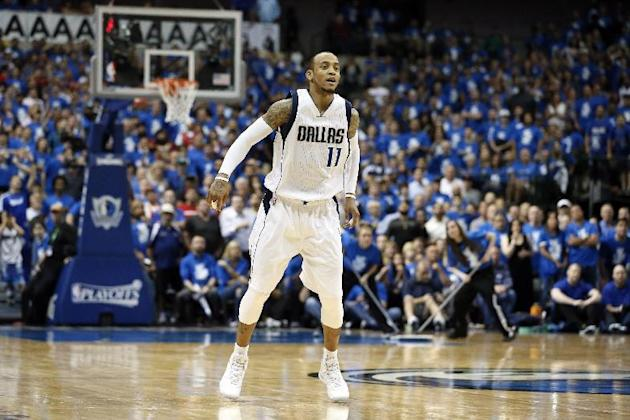 Dallas Mavericks' Monta Ellis (11) watches one of his sots in Game 4 in an NBA basketball first-round playoff series against the Houston Rockets Sunday April 26, 2015, in Dallas. (AP Photo/Tony Gu
