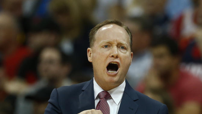 Atlanta Hawks head coach Mike Budenholzer signals to his players in the first half of an NBA playoff basketball game against the Brooklyn Nets  Sunday, April 19, 2015, in Atlanta. Atlanta won 99-92.  (AP Photo/John Bazemore)