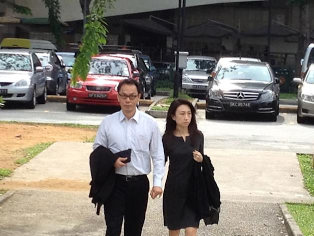 Former CNB chief Ng Boon Gay arrives at the Subordinate Courts with his wife Yap Yen Yen for his final day on the stand. (Yahoo! photo)