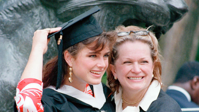 FILE - This June 9, 1987 file photo shows actress-model Brooke Shields with her mom Teri after graduation ceremonies at Princeton University in Princeton, N.J. Teri Shields, who launched daughter Brooke's on-camera career when she was a baby and managed the young star into her 20s, died last week in New York City. Jill Fritzo, a spokeswoman for Brooke Shields, confirmed the death on Tuesday, Nov. 6, 2012. The New York Times reports that the elder Shields died following a long illness related to dementia.  She was 79.  (AP Photo, file)