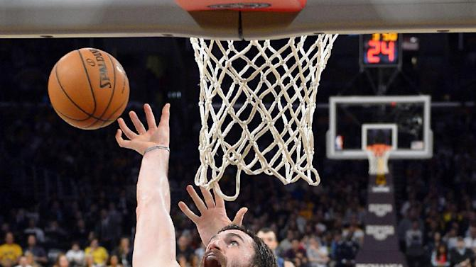 Minnesota Timberwolves forward Kevin Love, left, goes after a rebound along with Los Angeles Lakers center Pau Gasol, of Spain, during the first half of an NBA basketball game Sunday, Nov. 10, 2013, in Los Angeles