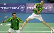 Ross Smith (R) hits a smash as Glenn Warfe looks on during a match in 2007. Australia's Olympic badminton preparations suffered a blow when three of the team were hit by a bout of food poisoning at their pre-Games training camp in England