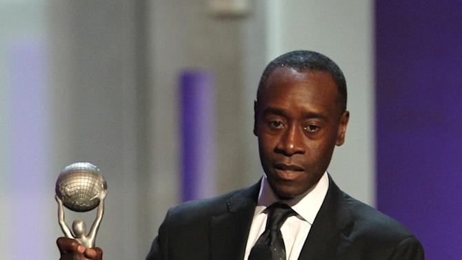 "Don Cheadle accepts the award for outstanding actor in a comedy series for ""House of Lies"" at the 44th Annual NAACP Image Awards at the Shrine Auditorium in Los Angeles on Friday, Feb. 1, 2013. (Photo by Matt Sayles/Invision/AP)"