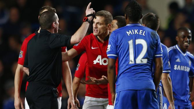 Manchester United's Vidic gestures towards referee Dowd after being sent off during their English Premier League soccer match against Chelsea at Stamford Bridge