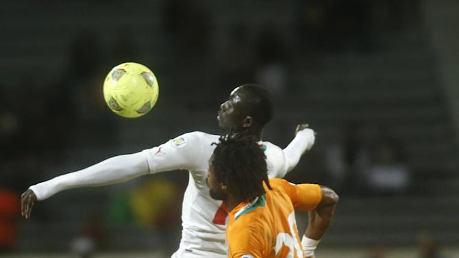 Ivory Coast's Gosso Jean-Jacques, right, is challenged by Senegal's Cisse Papis Demba, left, during their World Cup Group H qualifying soccer match at Mohammed V stadium in Casablanca, Morocco, Saturday Nov. 16, 2013. Ivory Coast qualified for the World Cup tournament by beating Senegal 4-2 on aggregate in a playoff for next year's finals in Brazil after a 1-1 draw