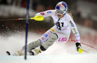 Lindsey Vonn, of the United States, slaloms past a pole during the first run of an alpine ski, women's World Cup slalom, in Lienz, Austria, Thursday, Dec. 29, 2011. (AP Photo/Giovanni Auletta)