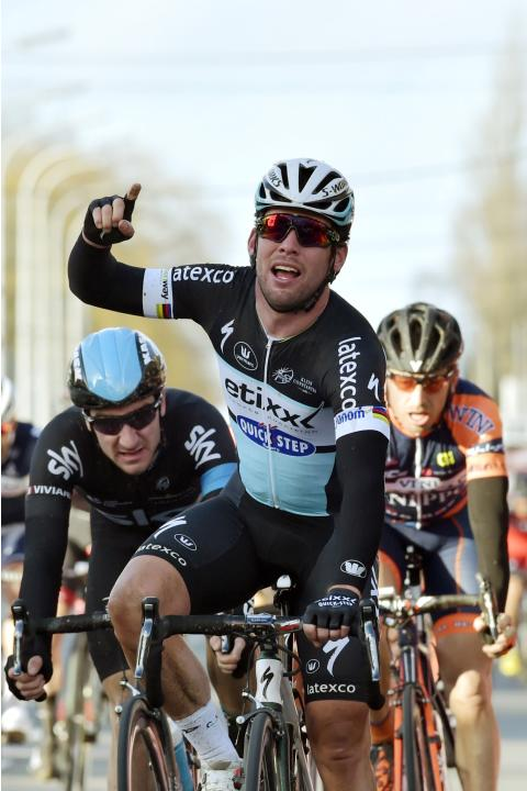 Etixx-Quick-Step rider Mark Cavendish of Britain crosses the finish line in Kuurne to win the Kuurne-Brussels-Kuurne cycling race