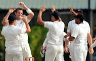 Tim Southee (2nd left) celebrates with teammates after he dismisses Tharanga Paranavitana in Colombo on Wednesday. Southee and Doug Bracewell rocked Sri Lanka with two wickets apiece to boost New Zealand's chances of posting a series-levelling win in the second and final Test