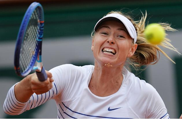 Russia's Maria Sharapova returns the ball to Australia's Samantha Stosur during the women's third round at the Roland Garros 2015 French Tennis Open in Paris on May 29, 2015