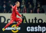 Bayern Munich's Dutch midfielder Arjen Robben scores during the German first division Bundesliga football match against Wolfsburg on February 15, 2013. Robben has admitted he is unhappy with his place on the bench as Bayern prepare for Tuesday's trip to Arsenal by extending their Bundesliga unbeaten run to 18 matches with victory at Wolfsburg