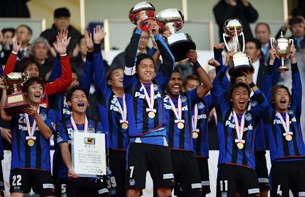 Gamba Osaka players celebrate on the podium after their victory over Montedio Yamagata, at the Emperor's Cup football tournament in Yokohama, on December 13, 2014