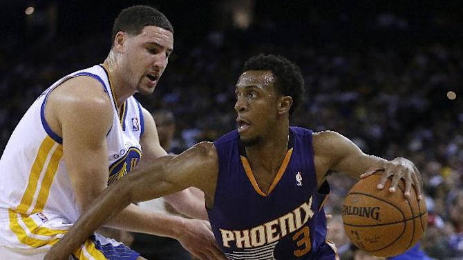 Phoenix Suns' Ish Smith, right, drives the ball against Golden State Warriors' Klay Thompson during the second half of an NBA basketball game Sunday, March 9, 2014, in Oakland, Calif