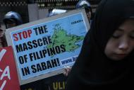 A group of Filipino Muslims and Christians protest in front of the Malaysian Embassy in Makati City, to urge Malaysian authorities to stop the military offensive against Filipinos in Sabah, 04 March 2013. Malaysian security forces launched a large-scale operation to defeat the intruders in Lahad Datu. At least 24 have been killed, 18 of them Filipinos and 8 Malaysian police, since firefights have broken out due to the standoff between Malaysian authorities and followers of Sulu Sultan Jamalul Kiram III. (Mike Alquinto, NPPA Images)