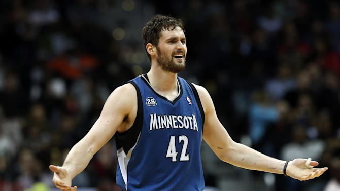 Minnesota Timberwolves forward Kevin Love  reacts after a foul call during the second half of the Timberwolves' NBA basketball game against the Atlanta Hawks on Saturday, Feb. 1, 2014, in Atlanta. Atlanta won 120-113 despite Love's 43 points and 19 rebounds