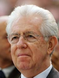 Italian Prime Minister Mario Monti listens to a speech during a visit to a Fiat carmaker plant on December 20, 2012 in Melfi, near Potenza. Monti rescued Italy from the brink of bankruptcy, launching long-delayed pension and labour market reforms and joining other eurozone leaders in battling the debt crisis.