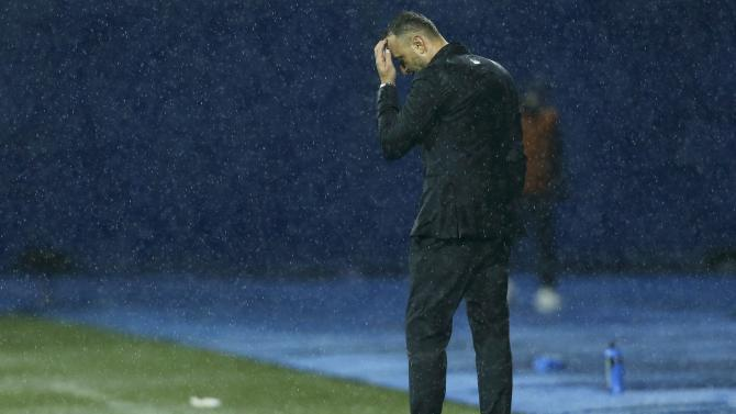 Bulgaria's coach Petev stands dejected on the pitch after Euro 2016 qualification soccer match against Croatia in Zagreb