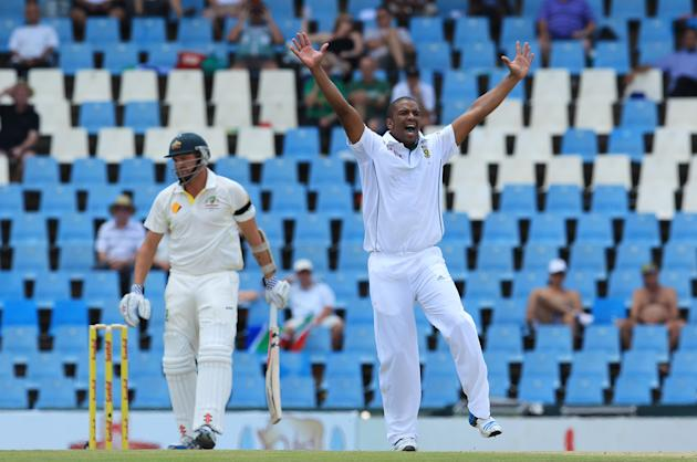 South Africa's bowler Vernon Philander, right, unsuccessfully appeals for LBW against Australia's batsman Shaun Marsh, left, on the second day of their their cricket test match against South A