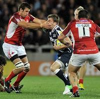 Sale Sharks' Mark Cueto, centre, is tackled by London Welsh's Matt Corker