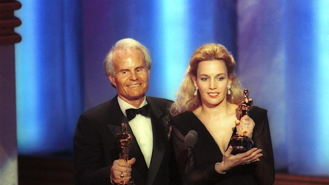 """FILE - In this March 26, 1990 file photo, producers Richard D. Zanuck, and Lili Fini Zanuck accept Oscars for best picture of the year for """"Driving Miss Daisy"""" at the 62nd annual Academy Awards in Los Angeles. According to his publicist, Richard D. Zanuck has died at age 77 on Friday, July 13, 2012, in Los Angeles. (AP Photo/Reed Saxon, File)"""