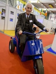 "James Dower sits astride the ""Tilt and Turn"", a petrol-powered tricycle whose trick is a flexible axle, at the International Exhibition of Inventions in Geneva on April 10, 2013. ""It's a very simple design really. Nothing can go wrong with it,"" Dower told AFP"