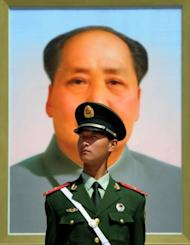 "A Chinese policeman stands in front of a portrait of the late Chinese leader Mao Zedong at Baijing's Tiananmen Square in April 2012. Bo Xilai, the son of a revered Communist revolutionary, won national fame with a draconian crackdown on criminal elements in Chongqing and a ""red revival"" campaign marked by the mass singing of old Maoist-era songs"